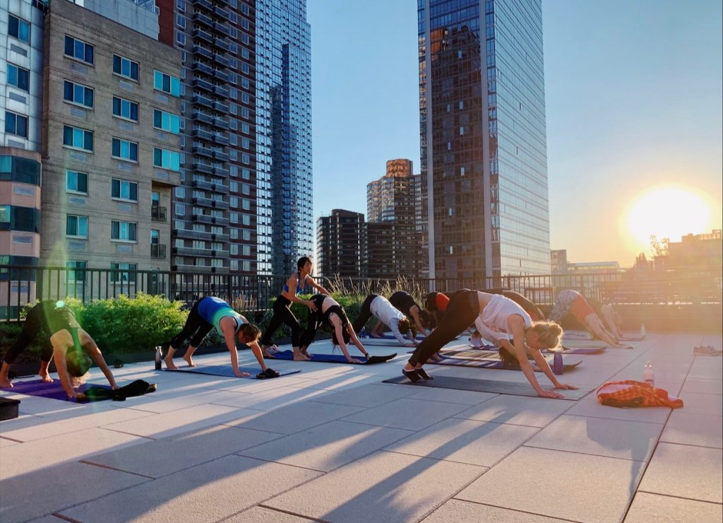 group yoga on the roof