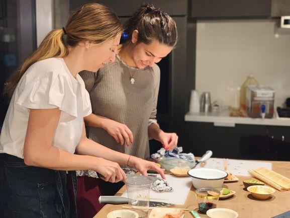 women making sushi together
