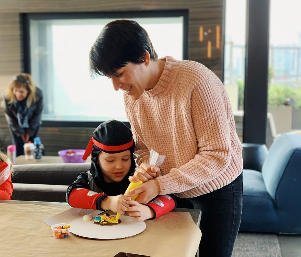 woman and child making cookies